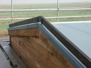 Barge board attached over roof apex.