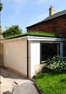 """""""Den"""" extension with a wildflower turf green roof."""