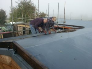 Stable roof showing membrane and Barge Board being installed