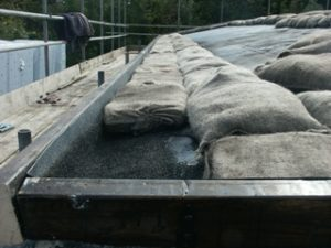 Shows the liner, barge boards and sand bags.